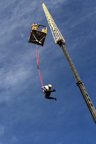 "Javier jumps 90 feet off a crane in Orlando, Florida, to test the Flightline Free Fall device. ""Taking one for the team!"" she says."
