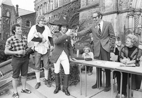 ER Mapper Dr. John Evans  judges the floats at the Homecoming Parade, October 1973 Photo: Robert Lansdale/U of T Archives B1998-0033 [ 731256-78 ]raster translator V1.0: Band 1 = Greyscale