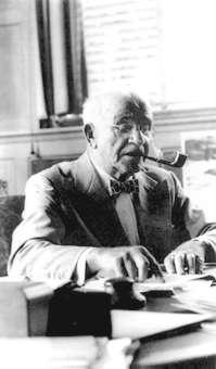 Samuel McLaughlin, shown at his desk in 1954