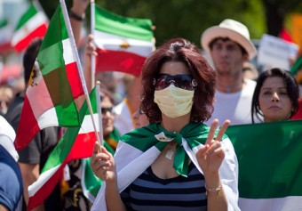 A woman in Toronto protests the results of the Iranian presidential election last summer