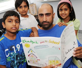 Author Asim Hussain and three of his children, who illustrated Khadijah Goes to School