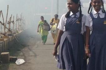 Construction smoke wreathes a bridge in Mumbai
