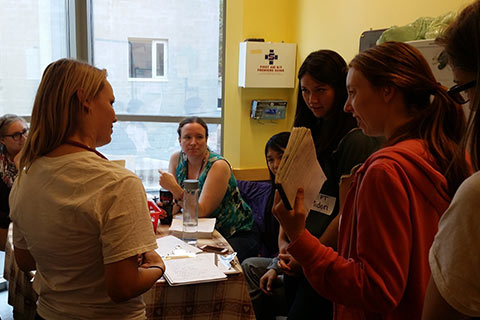 Student volunteers and preceptors discuss the day's cases at the IMAGINE clinic. Credit: Jelena Damjanovic