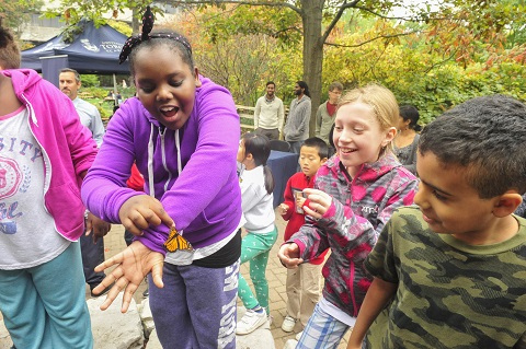 Children marvel at the monarchs at the opening of UTSC's Fred Urquhart Memorial Garden Photo: Ken Jones.
