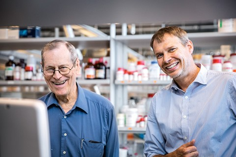 James Till (left) and Peter Zandstra celebrate the announcement of U of T's Medicine by Design initiative in Zandstra's laboratory. Photo by James Poremba.
