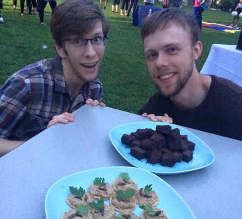 Students Phillip Daniels and Peter Francis, co-founders of the club Bug Bites, serve up cricket-flour brownies and crackers with cricket hummus and roasted mealworms on front campus in September. Photo by Elspeth Mathau.