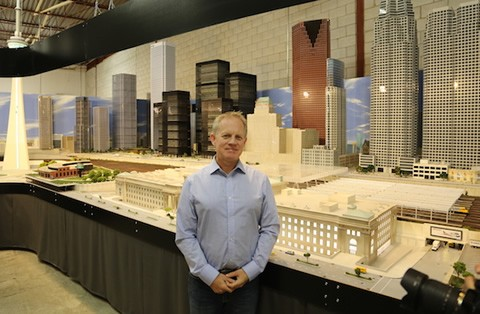 David MacLean (BASc 1985) stands in his own version of downtown Toronto. Photo courtesy of Our Home and Miniature Land