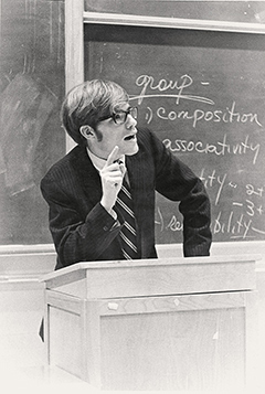 Photo of Bruce Kidd speaking behind a lectern