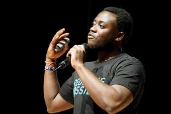Photo of Michel Chikwanine speaking into a microphone