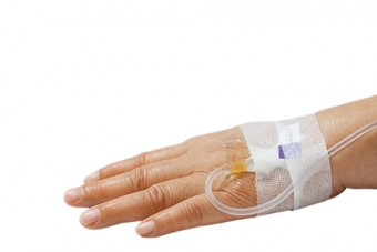 Photo of a hand attach to an IV