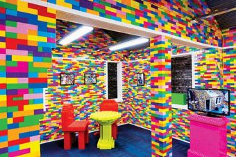 Photo of a room and furniture made of multicoloured lego