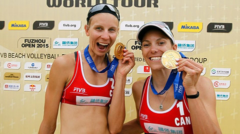 Photo of Kristina Valjas and Jamie Broder holding gold medals