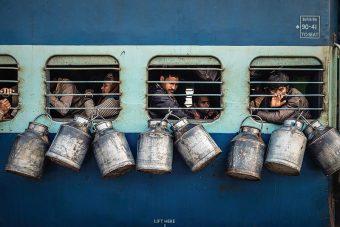 """People Winner: """"Milk Cartons on Side of Train"""" by Arjun Yadav"""