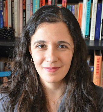 Headshot of Rebecca Rosenblum in front of a bookshelf