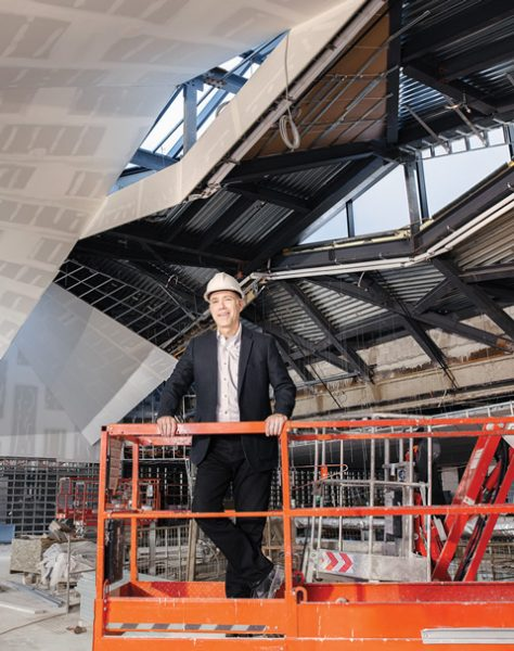Richard Sommer, dean of the John H. Daniels Faculty of Architecture, Landscape, and Design, surveys his faculty's new home, under construction on Spadina Crescent. Photo by John Hryniuk.