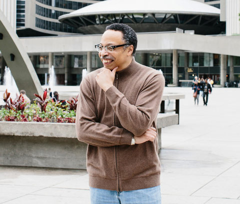 Photo of George Elliott Clarke in front of Toronto's City Hall