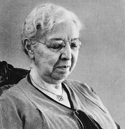 Headshot of Margaret Addison in reading glasses.