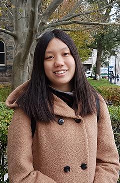 Head shot of Junye Zhang outside of Gerstein Library
