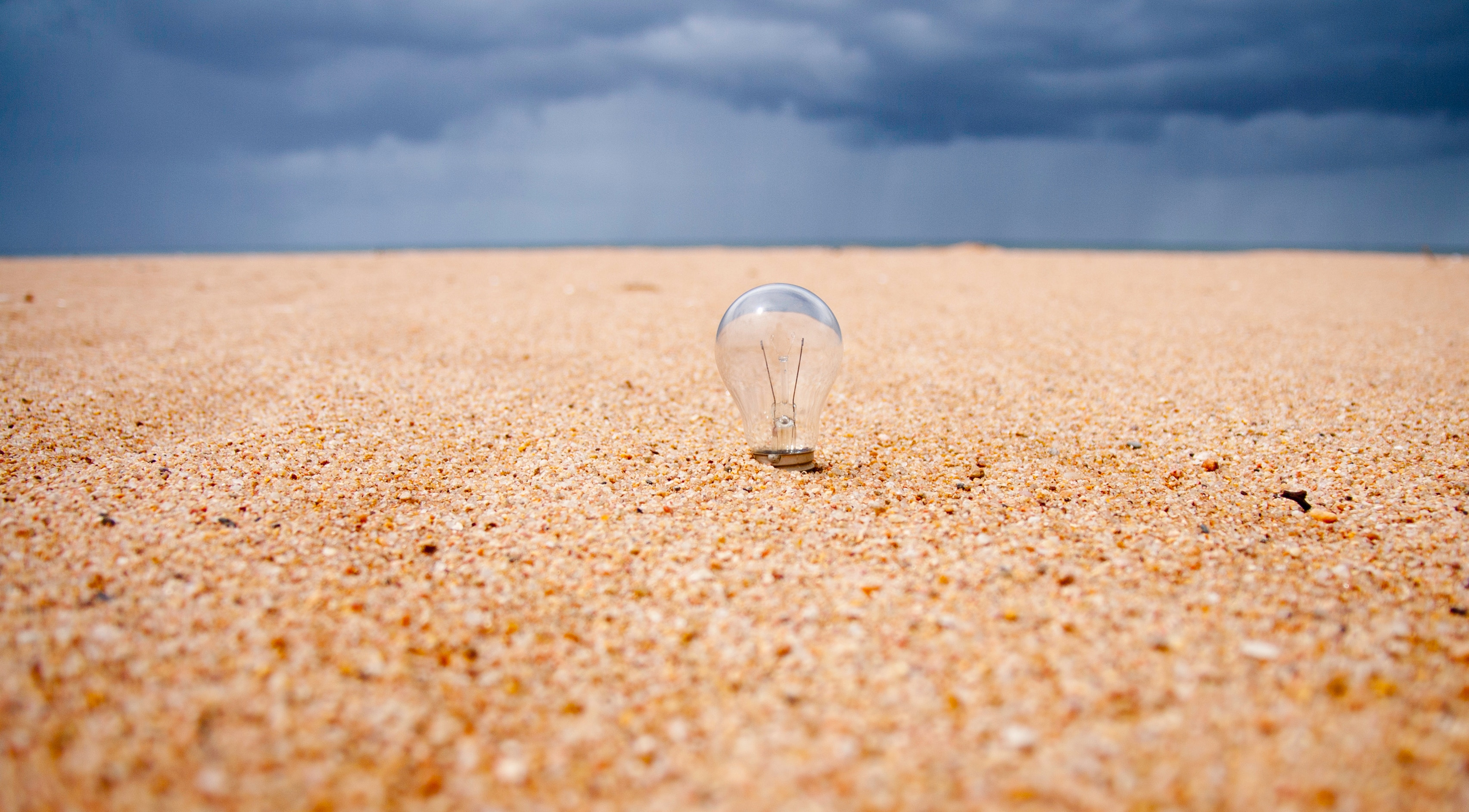 Lightbulb in sand