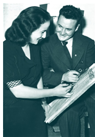 Varsity editor Betsy Mosbaugh looks over a 1944 edition of the paper with assistant editor Bob Grosskurth