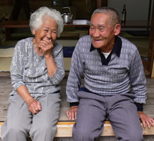 Photo of an elderly couple smiling