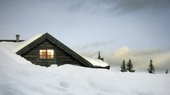 Image of a snowed-in cabin
