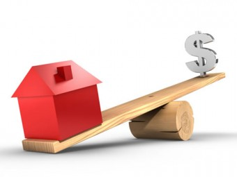Illustration of a see=saw. On one side, a house weighs down the lighter dollar sign.