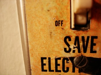 """A lightswitch with the words """"save electricity"""""""