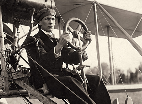 Douglas McCurdy at the wheel of a plane.