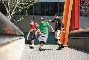 Photo of a group of young people skateboarding.