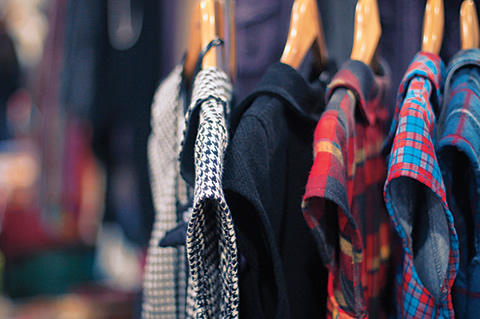 Photo of clothes on a rack.