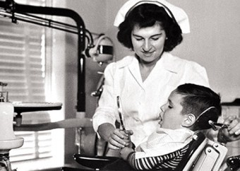 Photo of a nurse with a child in a dental practice