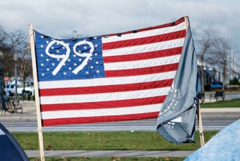 """Photo of an American flag with """"99"""" written over the star section."""