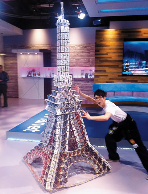 Spark Club's Hubert Ka with the Eiffel Tower featured on Daily Planet