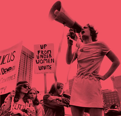 Photo of woman with a megaphone at a protest.