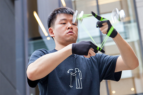 Wayne Ngan forms a triangle using his yo-yo. Photo by Mark Balson