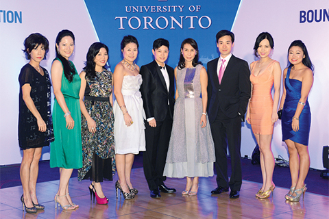 Daisy Ho (fourth from right) and Porcia Leung (fourth from left), president of the U of T Alumni Association in Hong Kong, pose with other members of the gala organizing committee. Photo by Oscar Yu