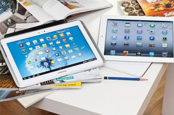 Photo of iPads on a desk with a pencil.