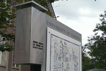 Photo of a UofT infomration kiosk showing a map.