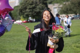 Photo of a student with flowers at convocation.