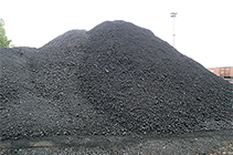 Photo of a pile of petroleum coke.