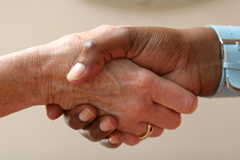 Photo of two hands in a handshake.
