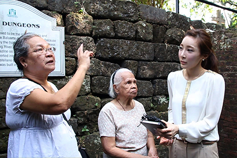 Photo of Jennifer Moon interviewing two women.