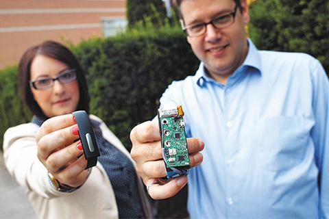 Bionym co-founders Foteini Agrafioti (left) and Karl Martin display the Nymi wristband.