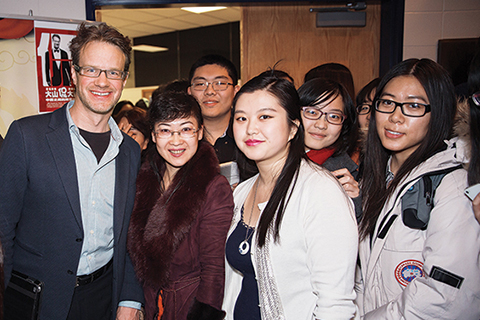 Photo of Mark Rowswell with students.