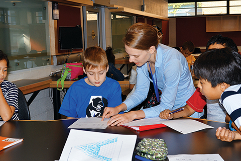 Instructor Janine Newton works with students at the Summer Math Kangaroo Camp