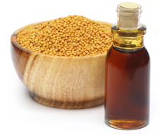Photo of a bowl of mustard seed and a liquid.
