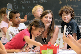 Photo of Tamara Mitchell with young students.