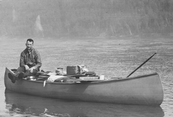 Photo of Harold Innis in a canoe.