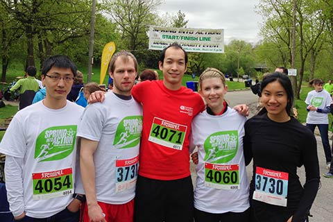 Photo of Wilfred Ip (centre) and others on the run.